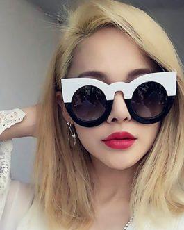 Stor oversized sort og hvid solbrille i cateye design